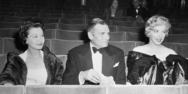 """Seated in the stalls of the Comedy Theater for the London premiere of Arthur Miller's play, """"A View From the Bridge,"""" are Vivien Leigh, her husband, Sir Laurence Olivier, and Hollywood's Marilyn Monroe, wife of the author. The trio arrived early to avoid the rush. — Getty"""