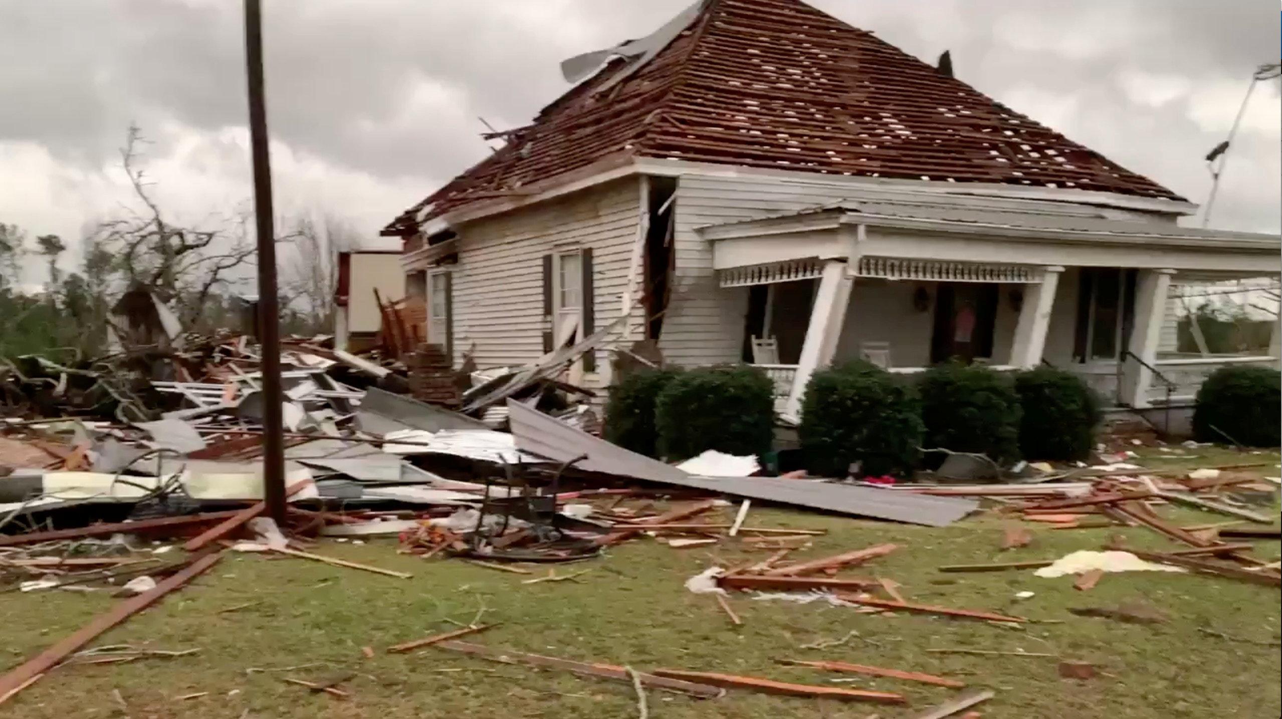 Debris and a damaged house seen following tornadoes in Beauregard.