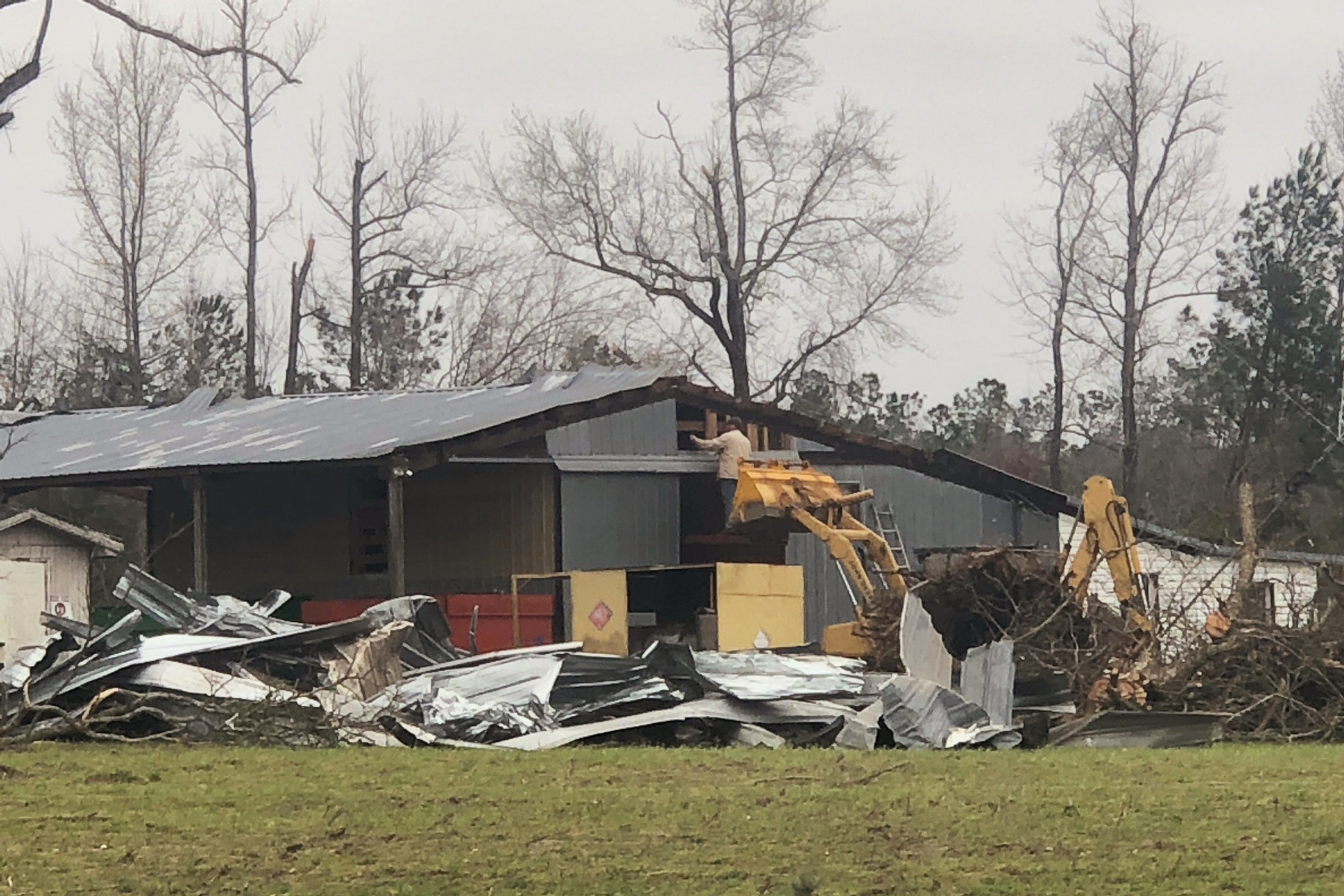 Debris is seen where two back-to-back tornadoes touched down in Lee County near Beauregard.
