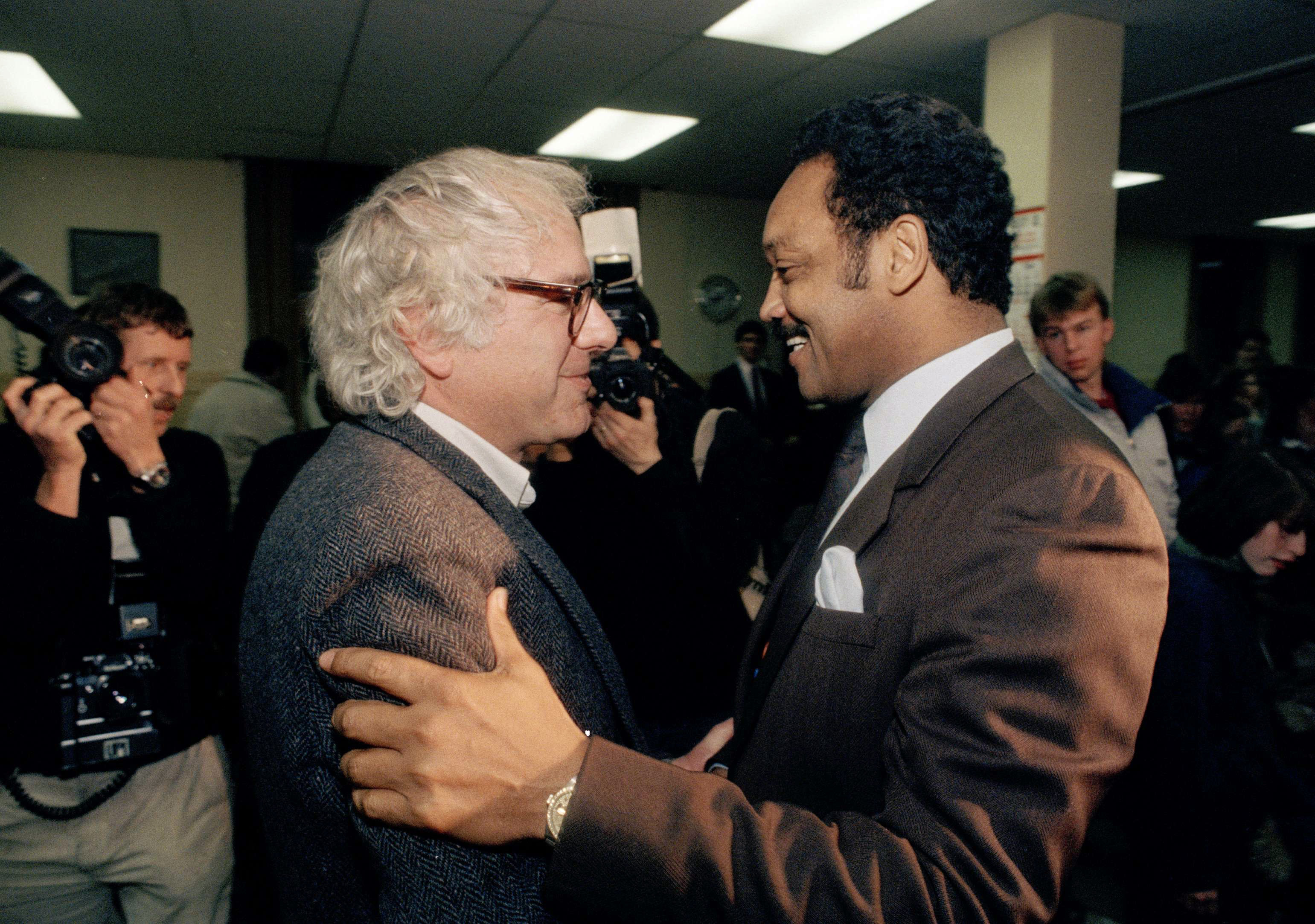 Bernie Sanders, then-mayor of Burlington, Vermont, greets then-presidential candidate Jesse Jackson at a campaign rally in 19