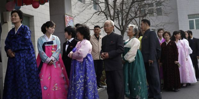People line up to vote during the election at a polling station in Pyongyang, North Korea, Sunday, March 10, 2019. Millions of North Korean voters, including leader Kim Jong Un, are going to the polls to elect roughly 700 members to the national legislature. In typical North Korean style, voters are presented with just one state-sanctioned candidate per district and they cast ballots to show their approval or, very rarely, disapproval.
