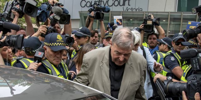 FILE - In this Feb. 26, 2019, file photo, Cardinal George Pell leaves the County Court in Melbourne, Australia. An Australian judge sentenced Wednesday, March 13, the most senior Catholic, Pell, to be convicted of child sex abuse to 6 years in prison for molesting two choirboys in a Melbourne cathedral more than 20 years ago. (AP Photo/Andy Brownbill, File)