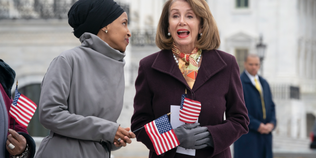 """Rep. Ilhan Omar, D-Minn., left, joins Speaker of the House Nancy Pelosi, D-Calif., as Democrats rally outside the Capitol ahead of passage of H.R. 1, """"The For the People Act,"""" a bill which aims to expand voting rights and strengthen ethics rules, in Washington, Friday, March 8, 2019. The House passed a resolution to condemn anti-Semitism and other bigotry on Thursday following debate over Omar's recent comments suggesting House supporters of Israel have dual allegiances. (AP Photo/J. Scott Applewhite)"""