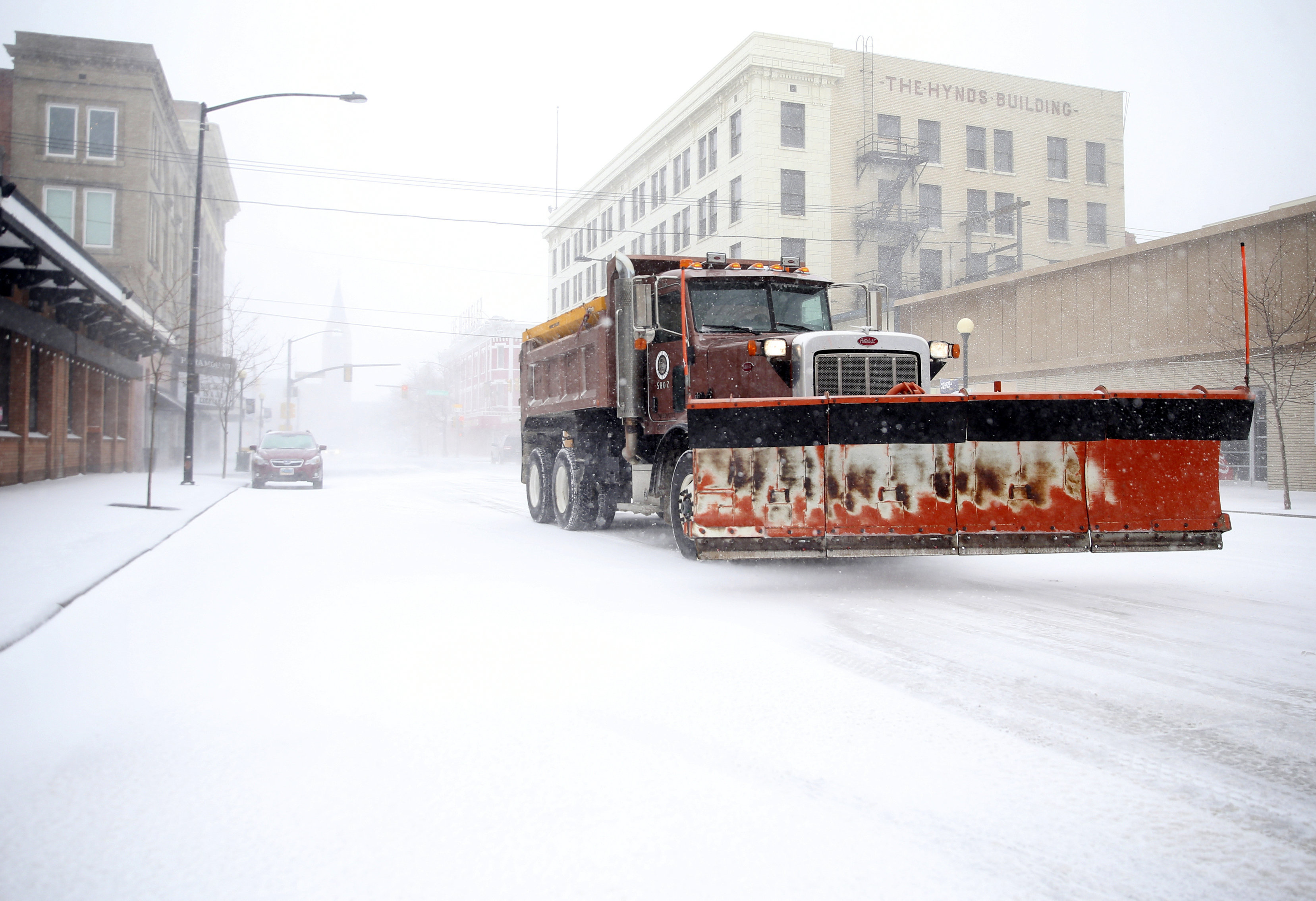A snow plow rumbles north on Capitol Avenue during a blizzard on Wednesday, March 13, 2019, in Cheyenne, Wyo. (Jacob Byk/The