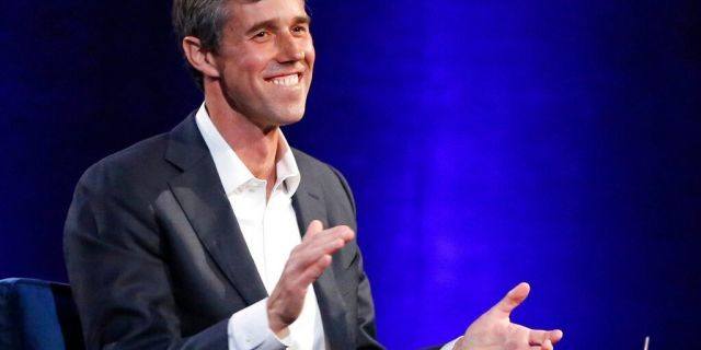 Beto O'Rourke laughing during an Oprah Winfrey in New York last February. (AP Photo/Kathy Willens, File)