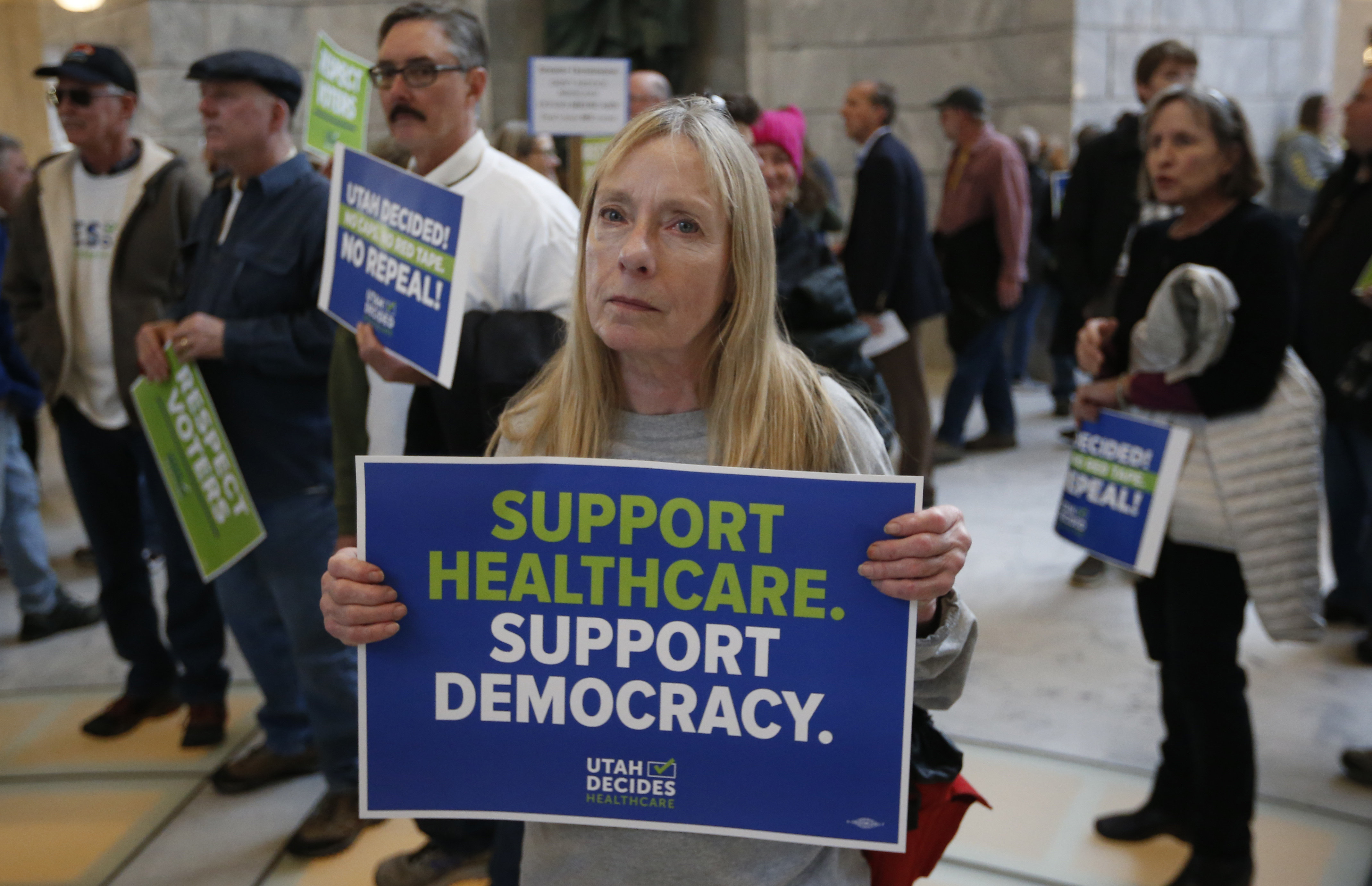 Bonnie Bowman, a supporter of a voter-approved measure to fully expand Medicaid, at a protest at the Utah Capitol in Salt Lak