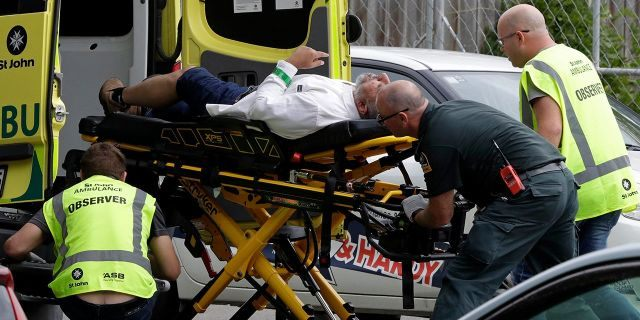 Ambulance staff take a man from outside a mosque in central Christchurch, New Zealand, Friday, March 15, 2019. (AP Photo/Mark Baker)