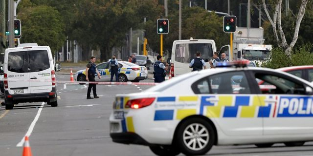 Police block the road near the shooting at a mosque in Linwood, Christchurch, New Zealand, on Friday, where seven people were killed.