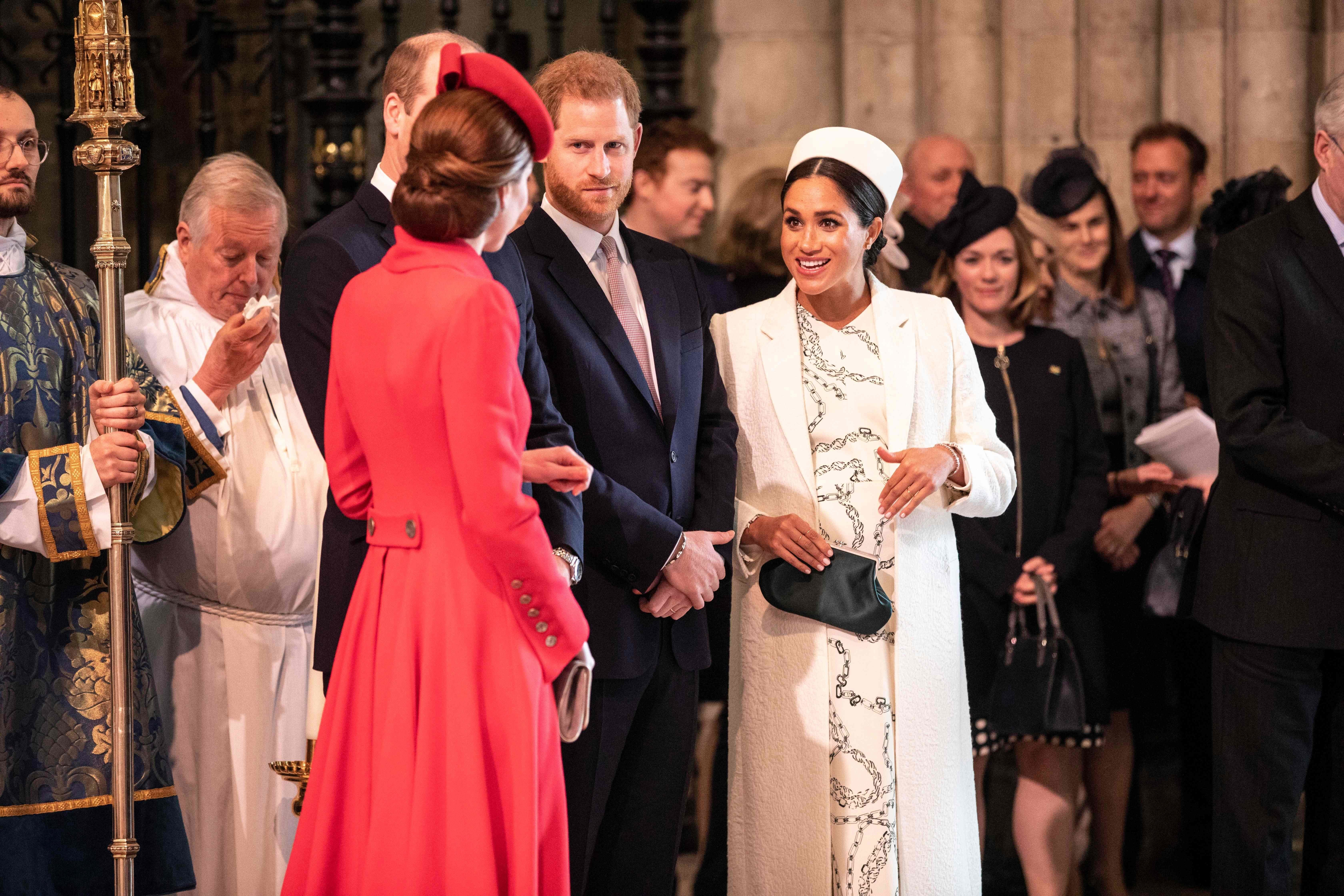 The Duchess of Cambridge (foreground) and Duchess of Sussex greet each other as they attend the Commonwealth Service with oth