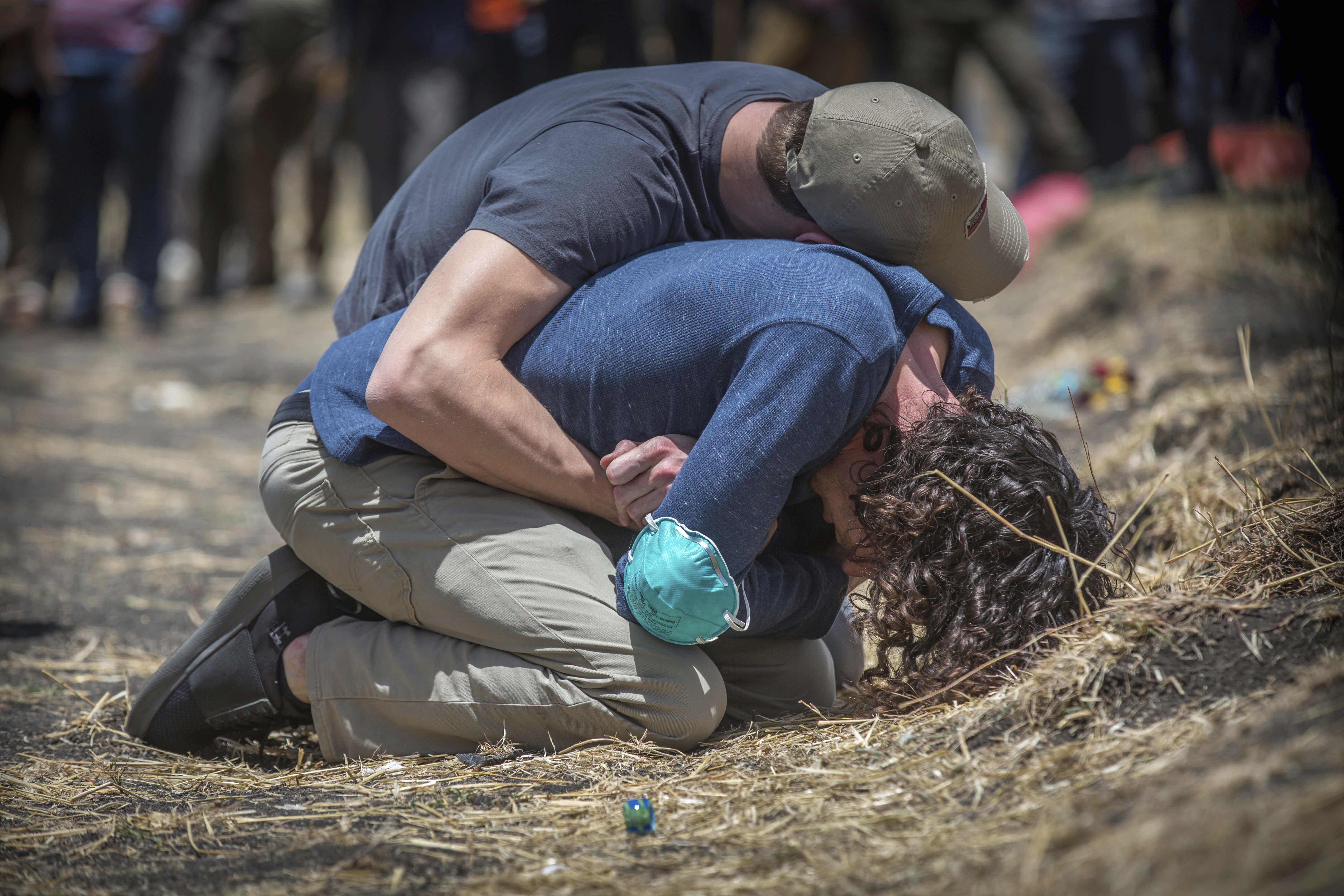 Relatives react at the crash scene of Ethiopian Airlines flight ET 302 near Bishoftu,Ethiopia, south of Addis Ababa, on