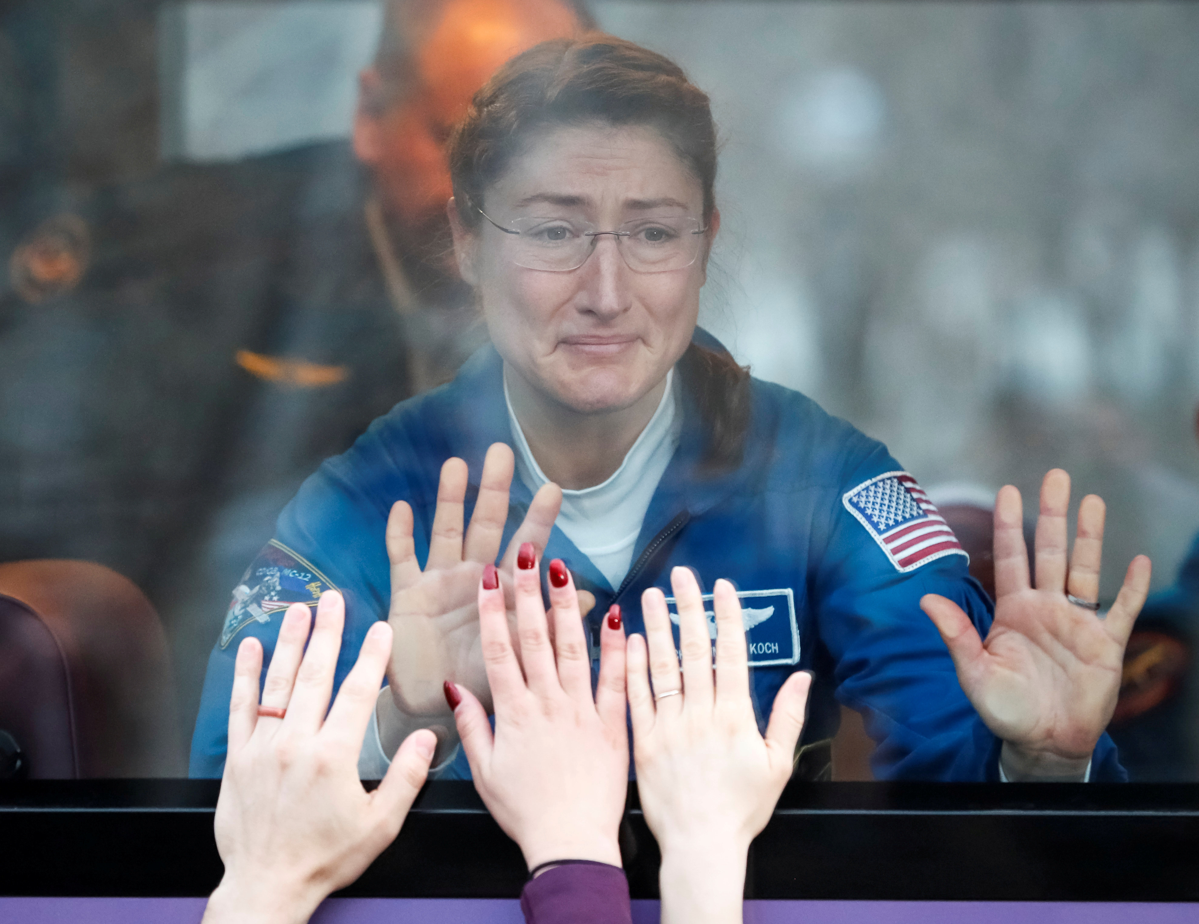 International Space Station crew member Christina Koch of the U.S. looks out a bus window before leaving for pre-flight prepa