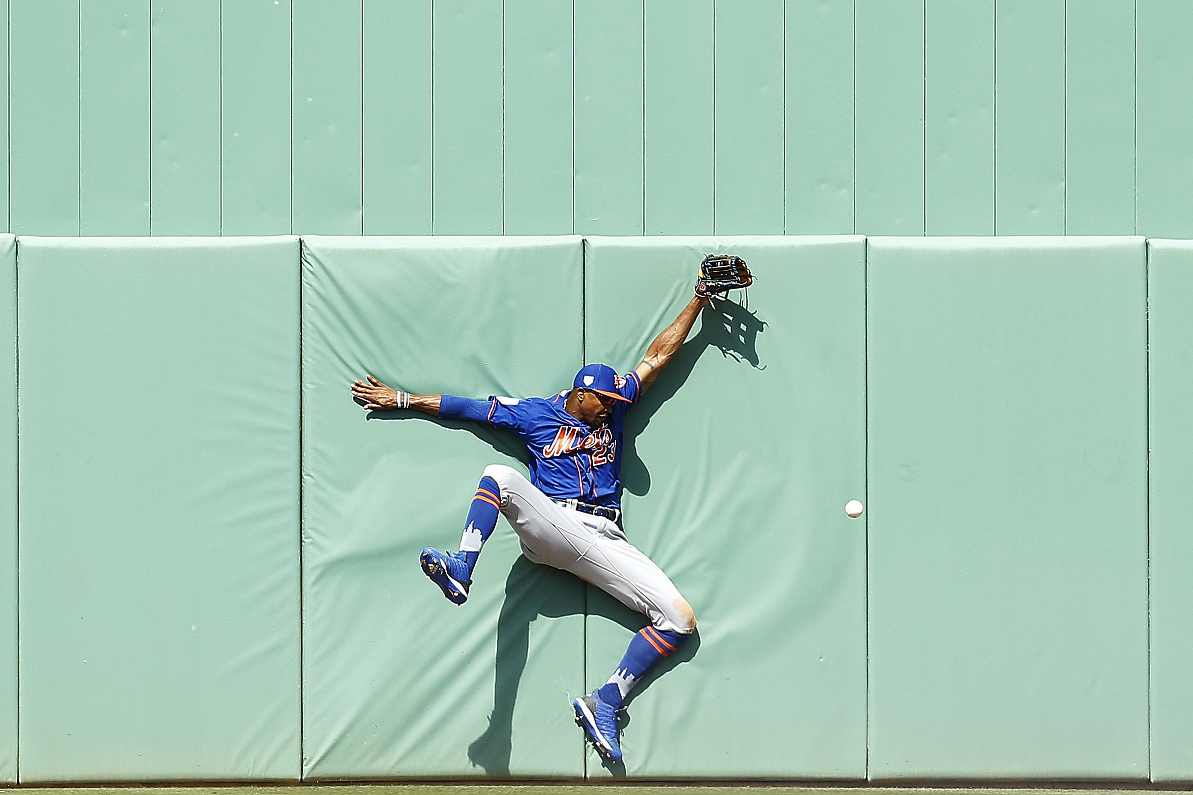 Keon Broxton of the New York Mets crashes into the wall as he attempts to catch a fly ball in the sixth inning of a Grapefrui