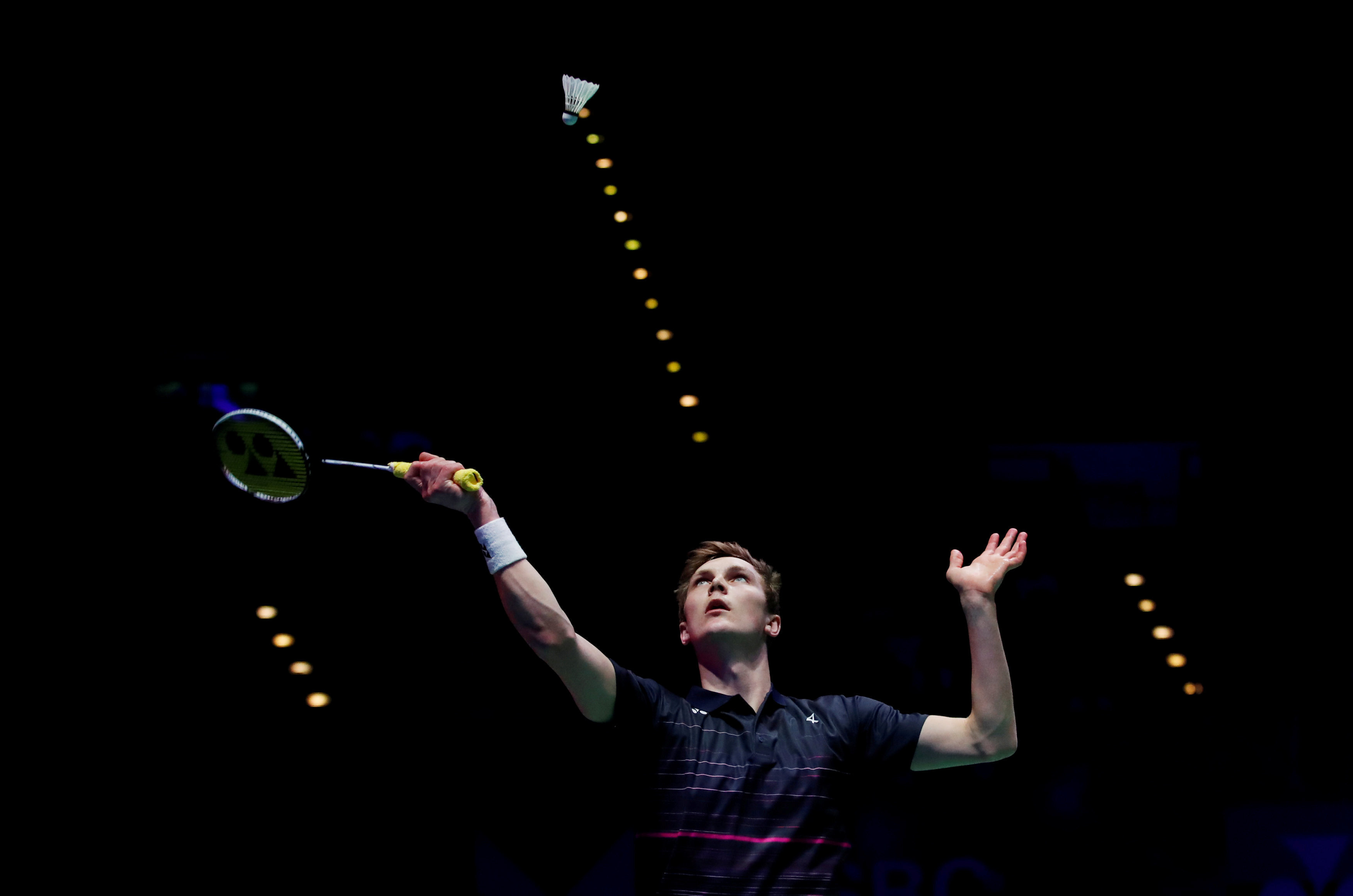 Denmark's Viktor Axelsen in action during the men's badminton final against Japan's Kento Momota inBirmingham, Britain,