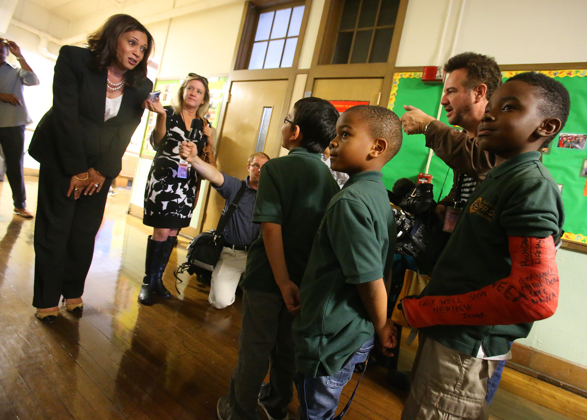 Harris, who was the attorney general for California at the time, talks with students at the East Oakland Pride Elementary Sch