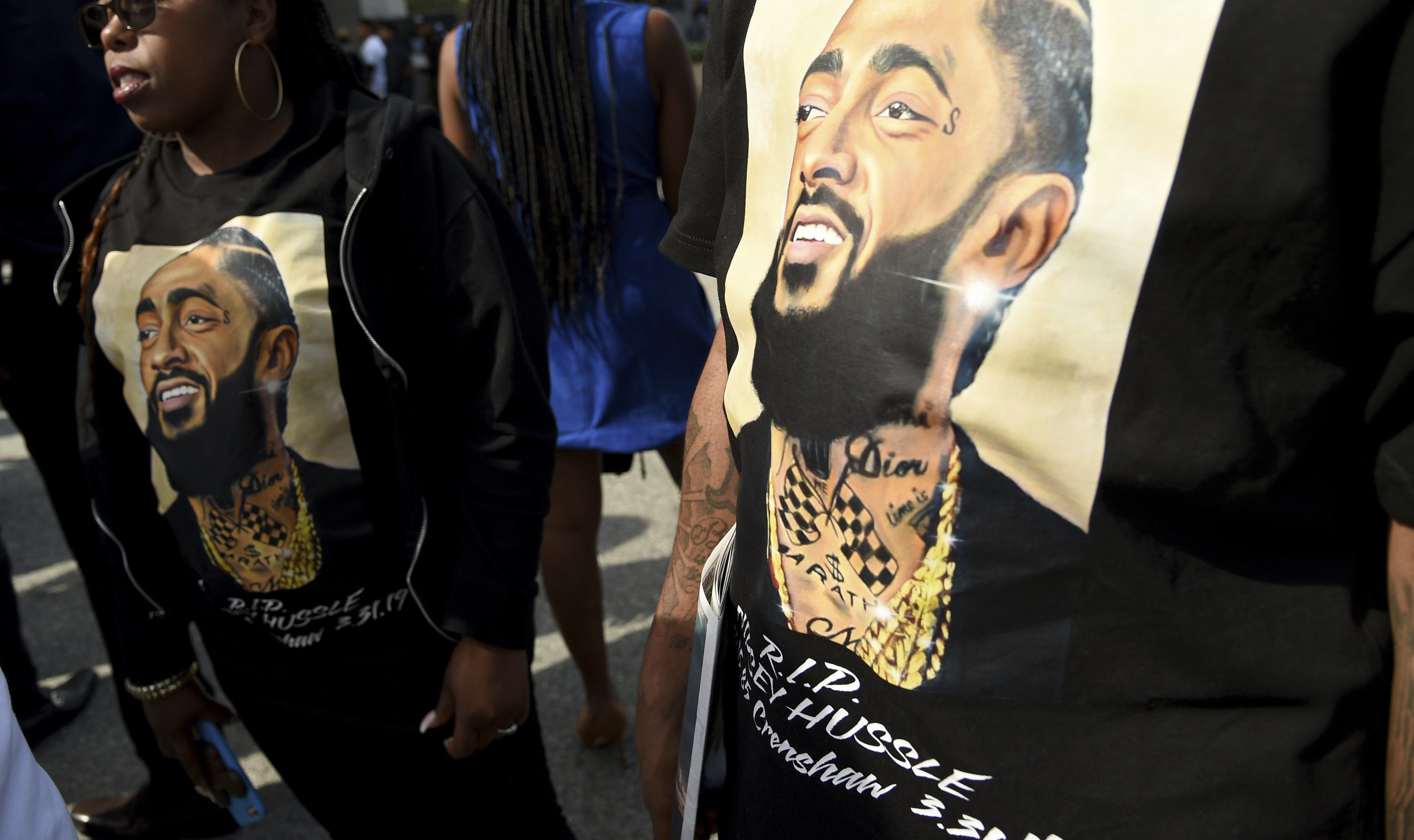 Guests wear t-shirts in tribute to Nipsey Hussle, whose given name was Ermias Asghedom, at the late rapper's Celebration of L