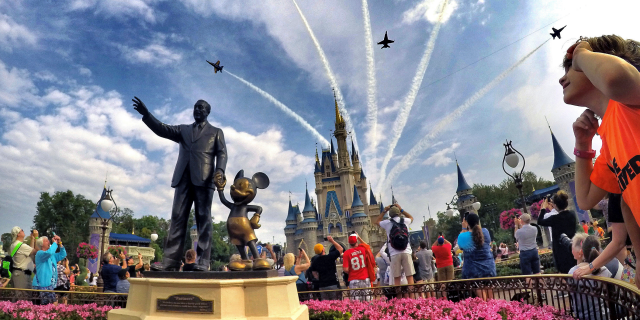 In this file photo, the Blue Angels, the U.S. Navy's legendary flight performance squadron, fly in formation over Cinderella Castle and the 'Partners' statue at the Magic Kingdom at Walt Disney World.