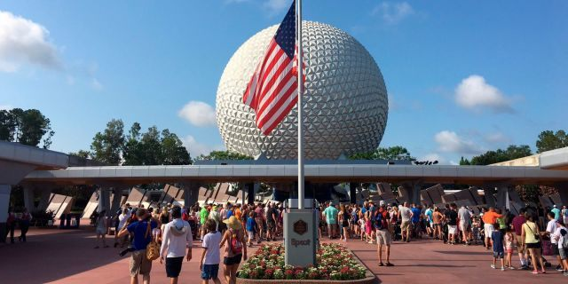 In this file photo, tourists walk at Epcot in Orlando, Fla.