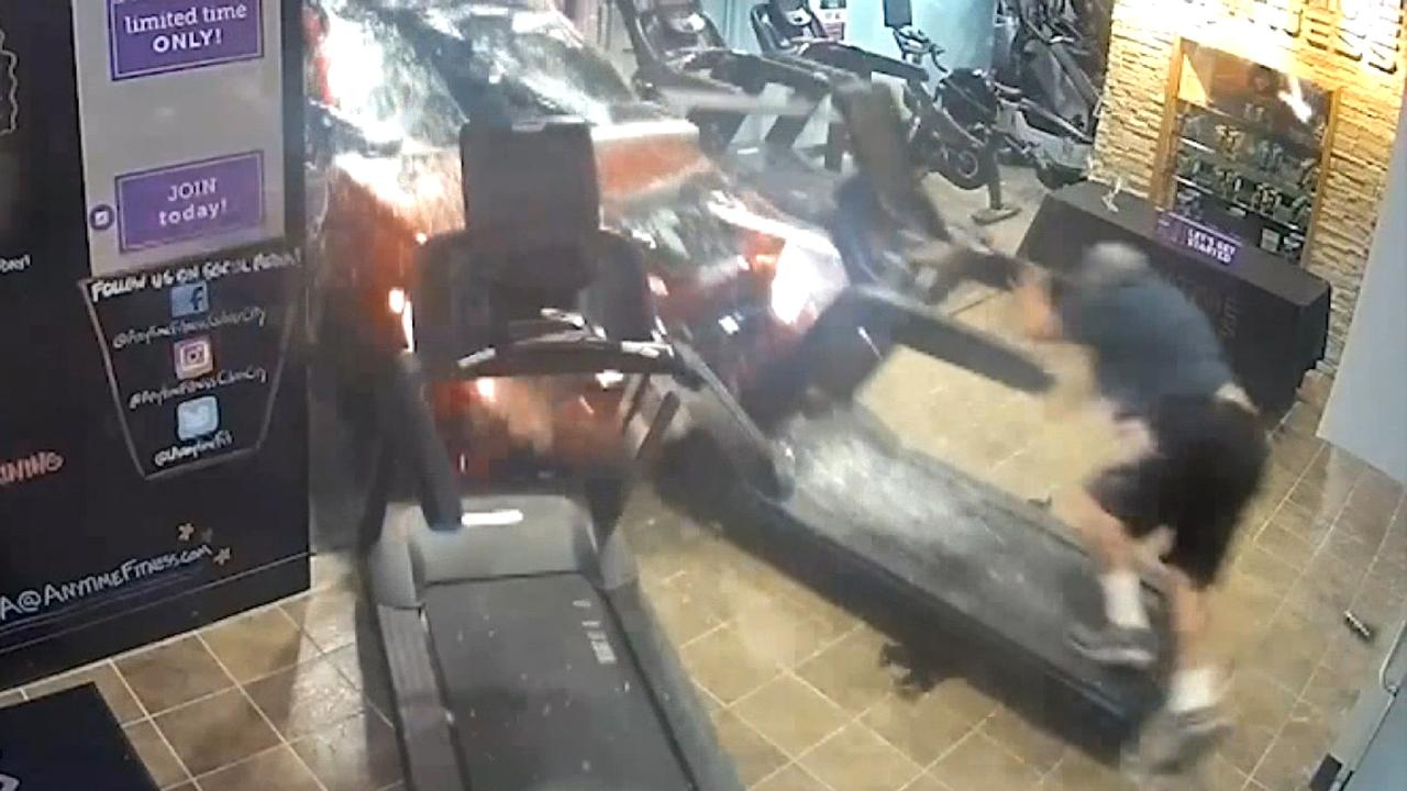 SUV slams into gym, injuring man on treadmill in scary crash caught on surveillance video