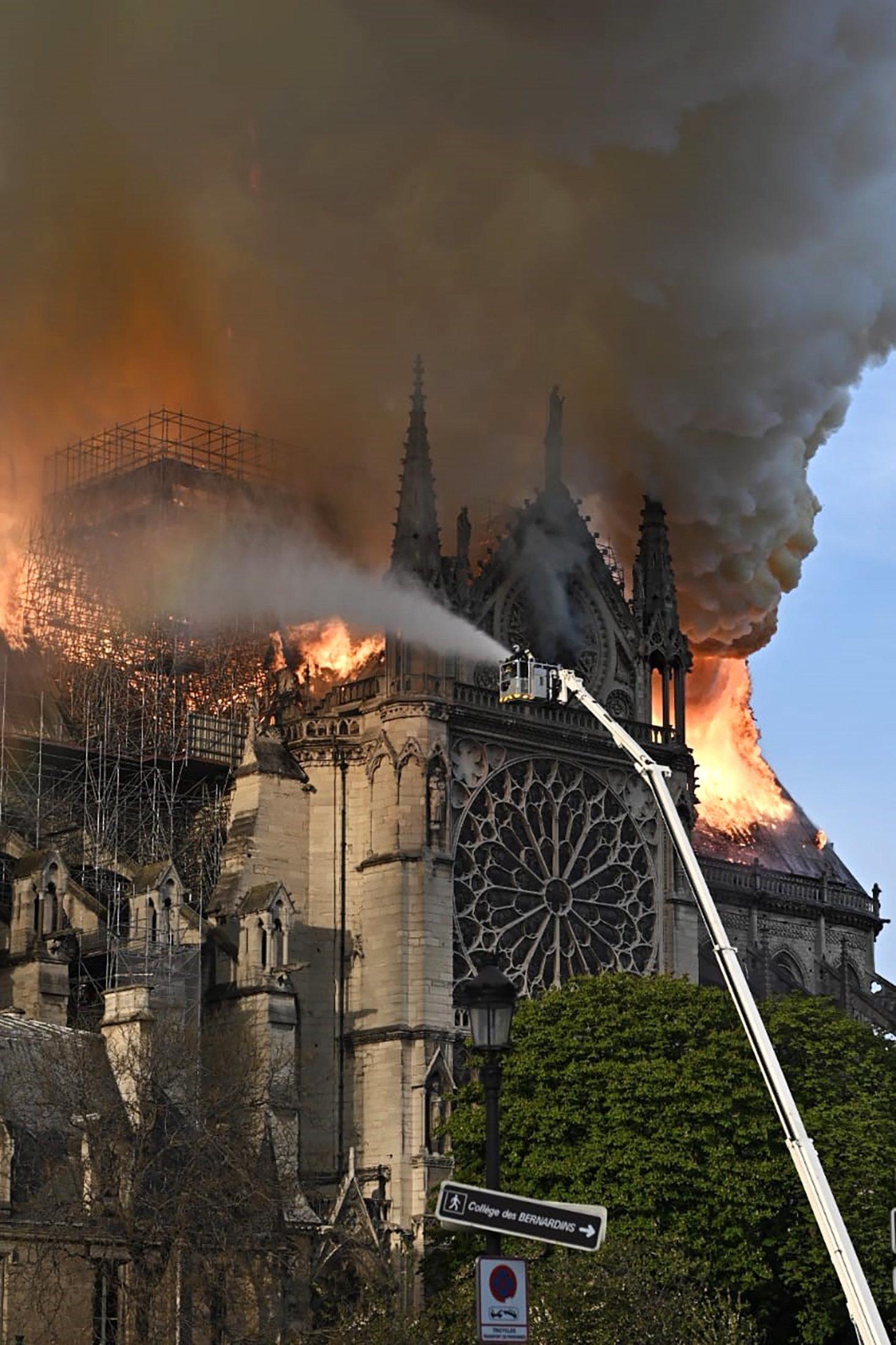 Emergency services attack a fire at Notre Dame de Paris.
