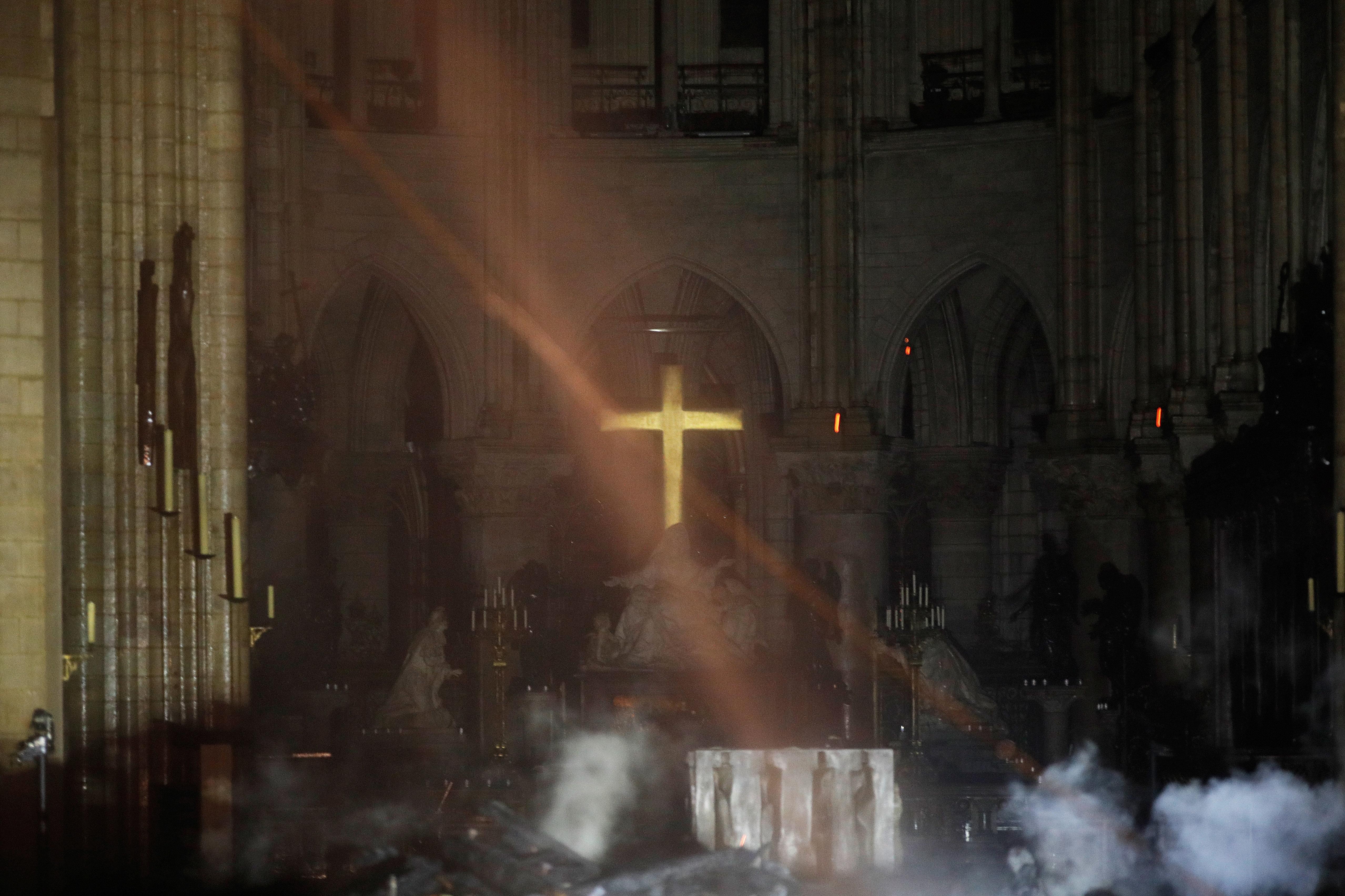 Smoke rises around the altar inside Notre Dame.