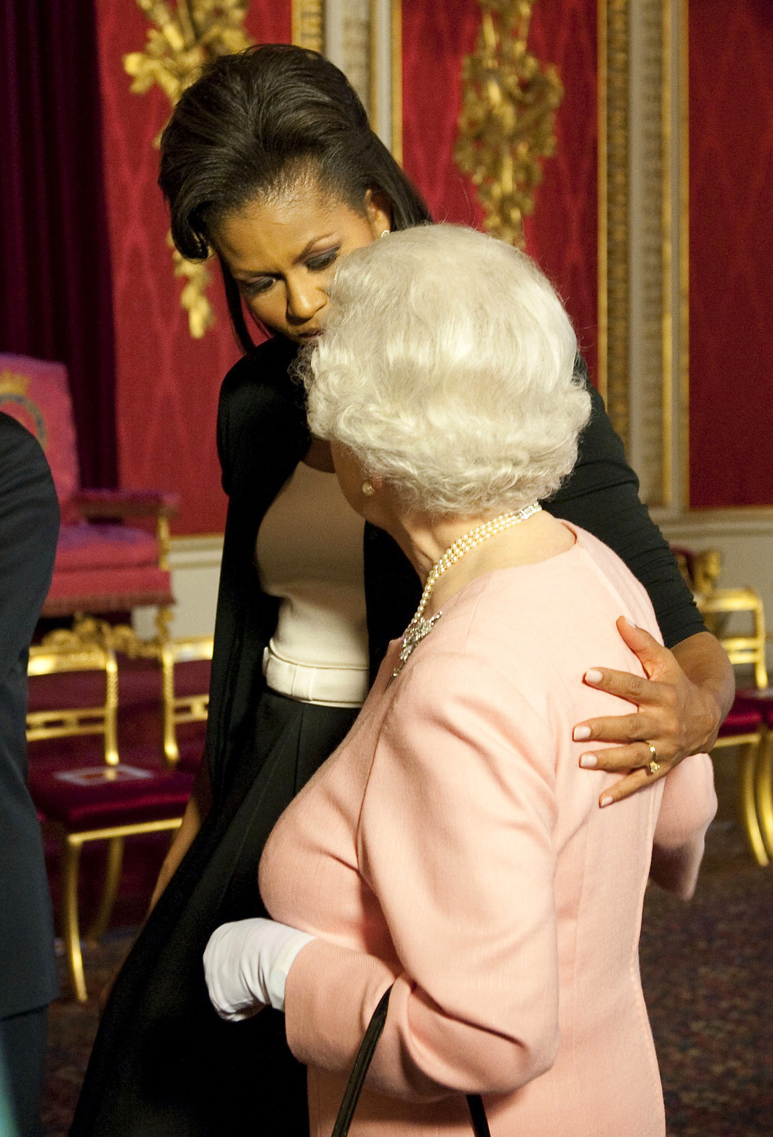 First lady Michelle Obama walks with Queen Elizabeth at a reception at Buckingham Palace on April 1, 2009.