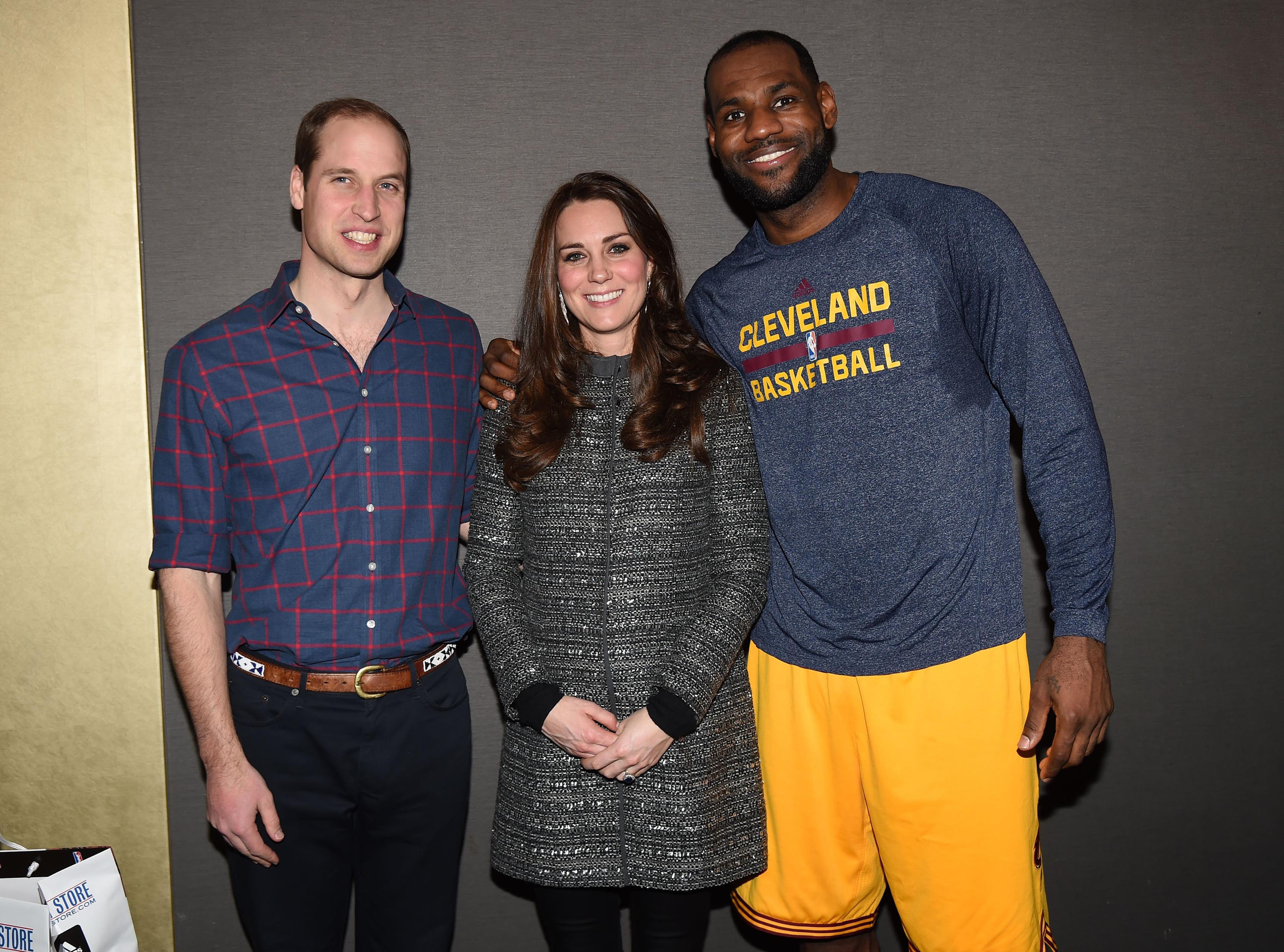 Prince William and Catherine, Duchess of Cambridge pose with LeBron James as they attend a Cleveland Cavaliers vs. Brooklyn N