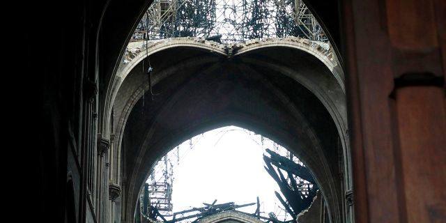 A hole is seen in the dome inside Notre cathedral in Paris. (Christophe Petit Tesson, Pool via AP)