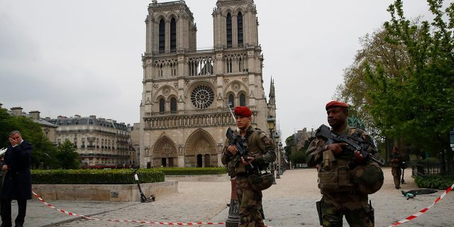 Firefighters declared success Tuesday in a more than 12-hour battle to extinguish an inferno engulfing Paris' iconic Notre Dame cathedral that claimed its spire and roof, but spared its bell towers.