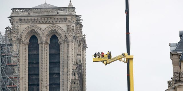 Experts are assessing the blackened shell of Paris' iconic Notre Dame cathedral to establish next steps to save what remains after a devastating fire destroyed much of the almost 900-year-old building.