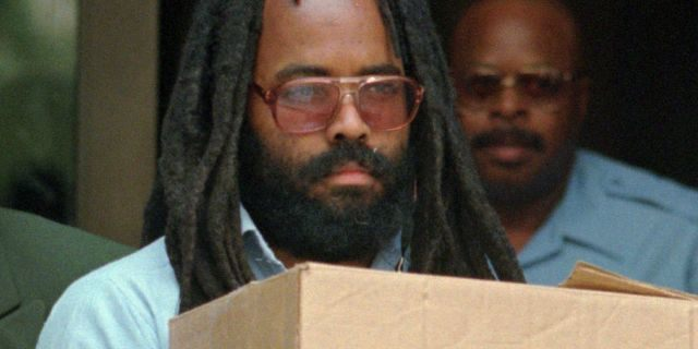 FILE - In this July 12, 1995 file photo, Mumia Abu-Jamal leaves Philadelphia's City Hall after a hearing. (AP Photo/Chris Gardner, File)