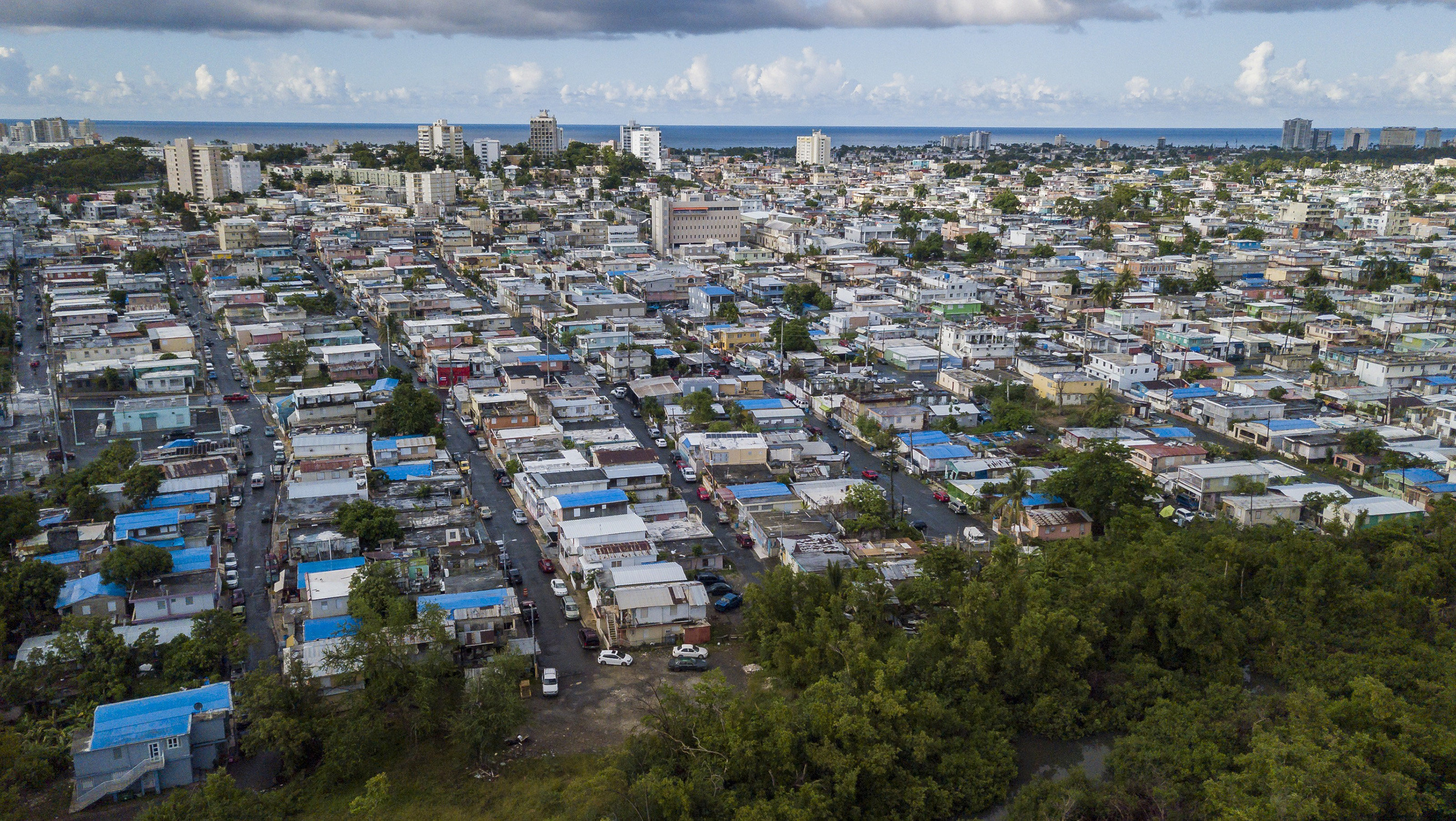 The San Juan neighborhood ofMartín Peña is regularly flooded by a canal that sends trash, rats and human