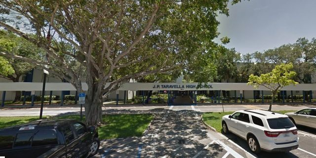 A Florida deputy was been placed on restricted duty after he was seen forcefully restraining a pepper-sprayed J. P. Tavarella High School student.