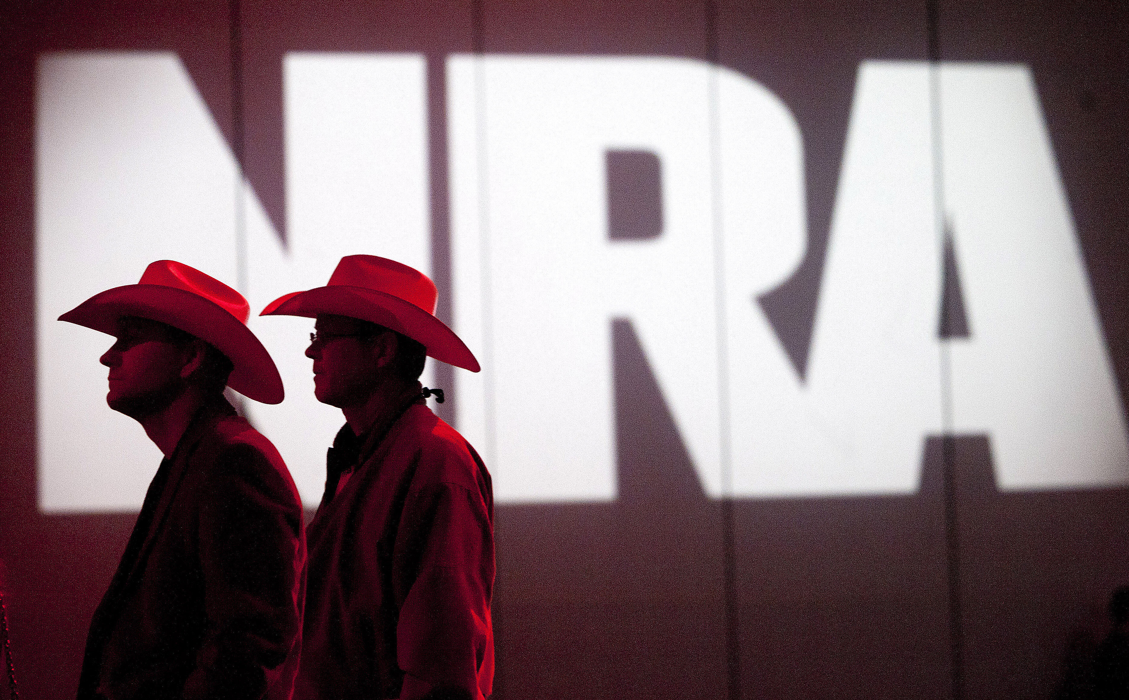 In this 2013 file photo, NRA members listen to speakers during the NRA Annual Meeting in Houston. The National Rifle Associat