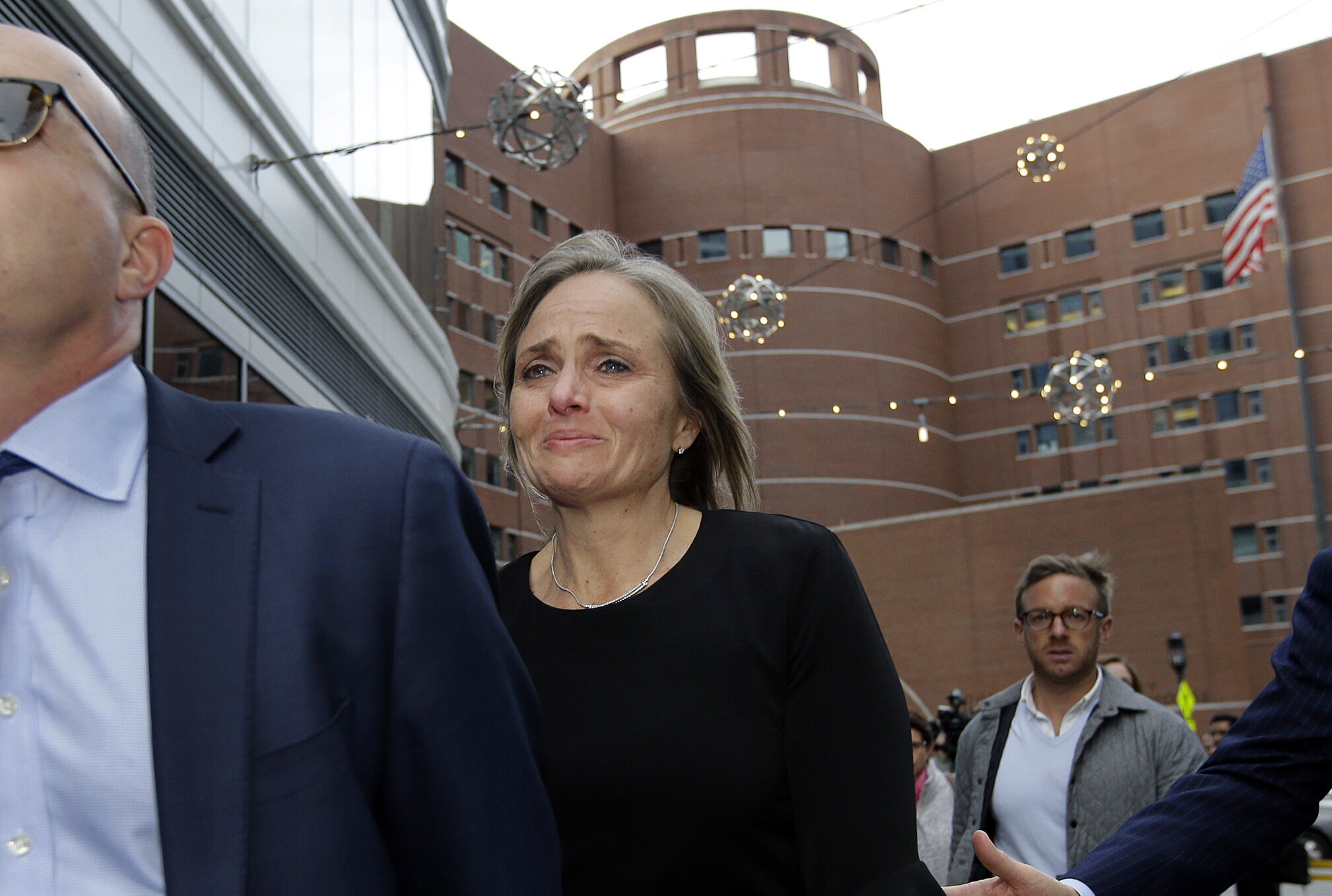 District Judge Shelley M. Richmond Joseph departs federal court, Thursday, April 25, 2019, in Boston after facing obstruction