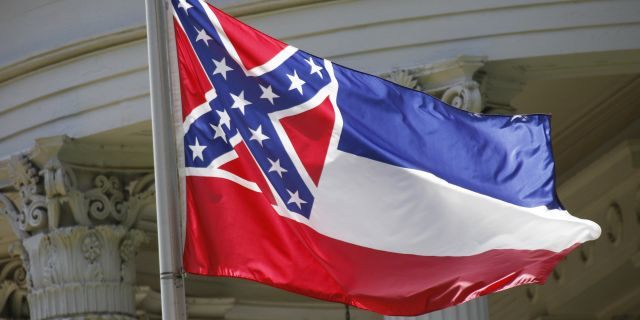 The state flag of Mississippi flies at the Governor's Mansion in Jackson, Miss. (Associated Press)