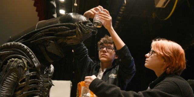 "North Bergen High School's Xavier Perez, 16, the Alien, is covered in slime by his handlers Eddie Mantilla, 15, and Cassandra Klima, 16, as they work on the play ""Alien,"" an adaptation of the Ridley Scott movie, in North Bergen, N.J."
