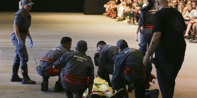 Model Tales Soares is taken from the catwalk by paramedics after he collapsed during Sao Paulo Fashion Week in Sao Paulo, Brazil, Saturday, April 27, 2019. A statement from organizers said that Soares died after taking ill while participating in the Sao Paulo's Fashion Week.(Leco Viana/Thenews2 via AP)