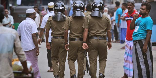 Sri Lankan policeman patrol in a Muslim neighborhood before Friday prayers in Colombo, Sri Lanka, Friday, April 26, 2019. (AP Photo/Manish Swarup)