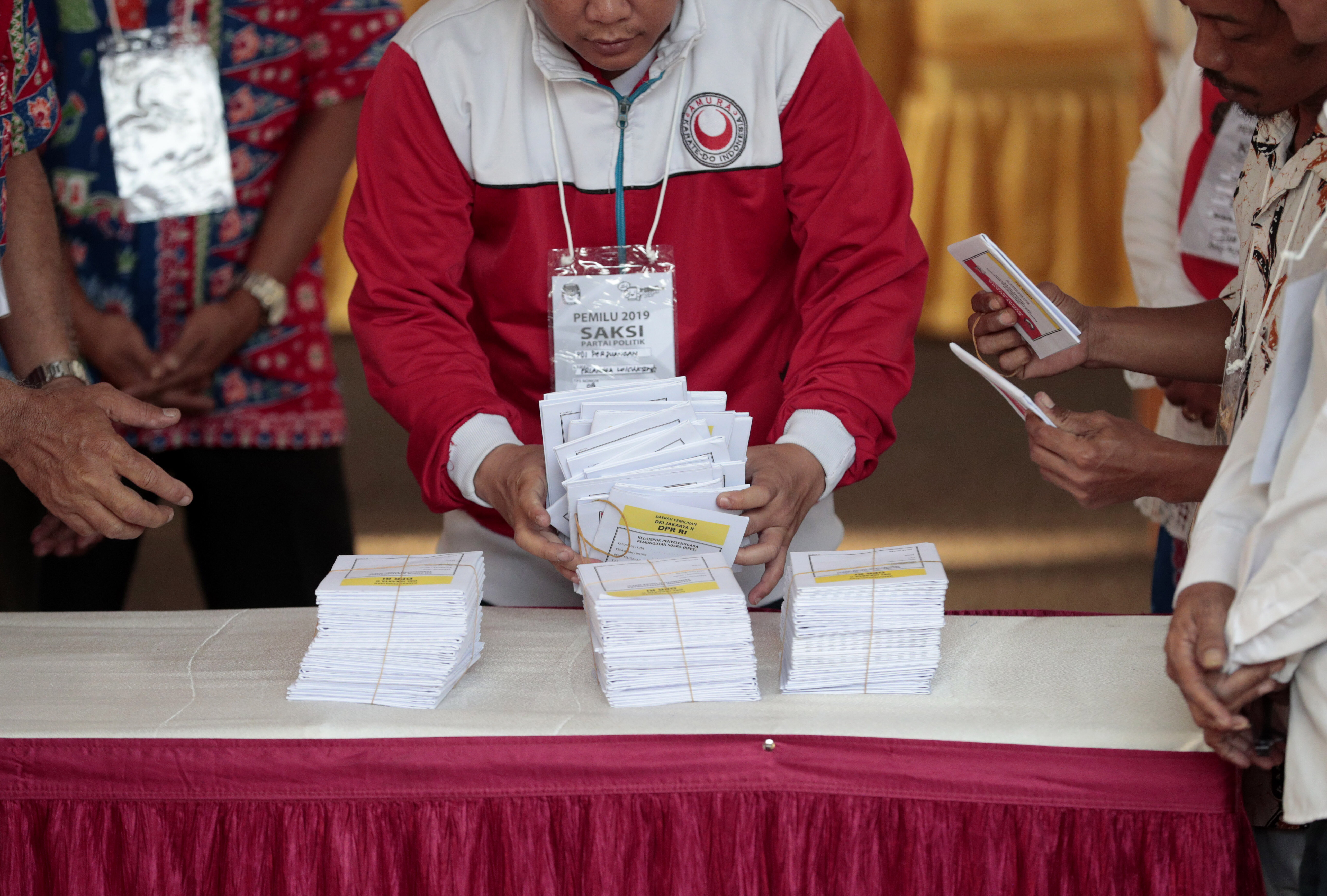 Electoral workers count ballots during the election at a polling station in Jakarta, Indonesia, on April 17, 2019.