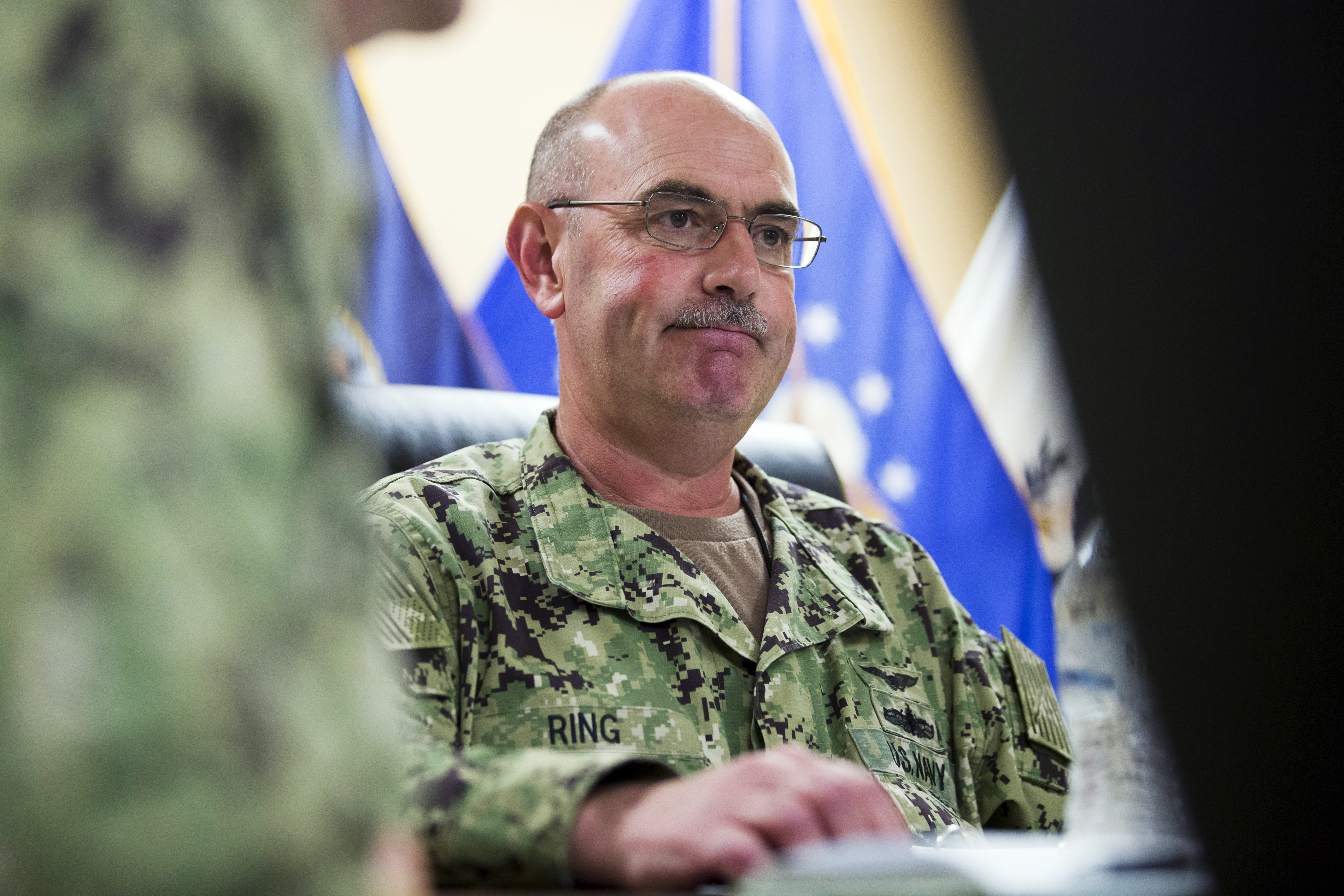 Navy Rear Adm. John Ring was relieved of duty Saturday.