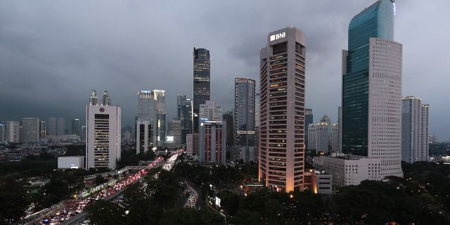 Indonesia's decades-long discussion about building a new capital has inched forward after President Joko Widodo approved a long-term plan for the government to abandon overcrowded, sinking and polluted Jakarta. (AP Photo/Dita Alangkara)