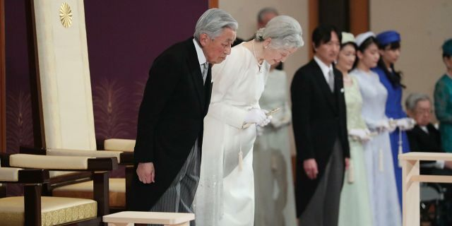 Japan's Emperor Akihito, left, and Empress Michiko, second left, bow as they prepare to leave after the ceremony of his abdication at the Imperial Palace in Tokyo, Tuesday. (Japan Pool via AP)
