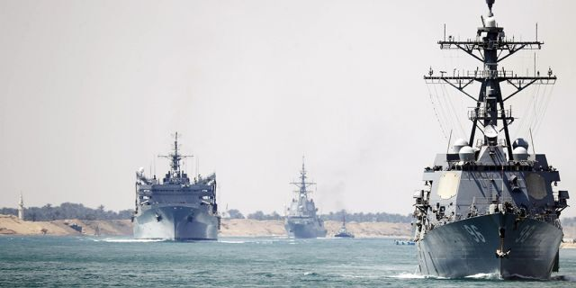 In this photo provided by the U.S. Navy, the Abraham Lincoln Carrier Strike Group transits the Suez Canal, Thursday, May 9, 2019.