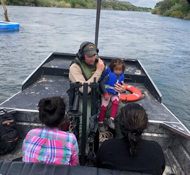 Del Rio Station marine agents rescue migrant family from a makeshift raft that became stranded in the Rio Grande. (Photo: U.S. Border Patrol/Del Rio Sector)