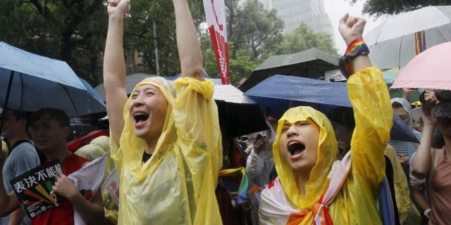 Same-sex marriage supporters cheer outside the Legislative Yuan in Taipei, Taiwan, on Friday, after Taiwan's legislature has passed a law allowing same-sex marriage in a first for Asia. (Associated Press)