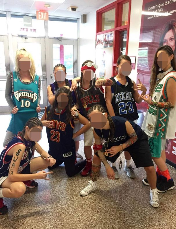 A photo of Memorial High School students wearing cornrows and fake tattoos for Spirit Week.