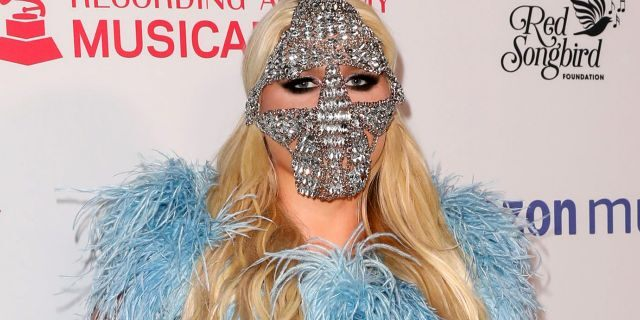 Kesha attended the MusiCares Concert for Recovery on Thursday night wearing a blue sequined gown by designer Cheng-Huai Chuang, with a crystal mask and silver glove for accessories. (Photo by Paul Archuleta/FilmMagic)