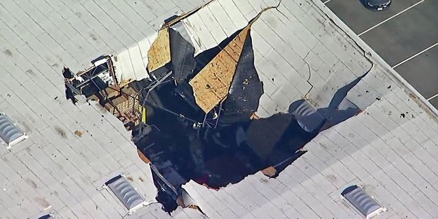 This photo taken from video provided by KABC-TV shows where an F-16 fighter jet crashed into a warehouse just outside March Air Reserve Base in Riverside, Calif., on Thursday. (Associated Press)