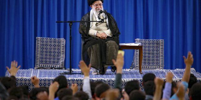 In this picture released on Wednesday, May 22, 2019, by an official website of the office of the Iranian supreme leader, Supreme Leader Ayatollah Ali Khamenei attends a meeting with a group of students as they chant slogans, in Tehran, Iran.