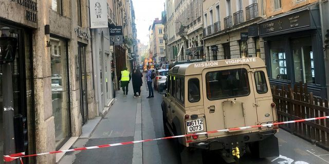 """A vehicle of French anti terrorist plan """"Vigipirate Mission"""", is seen near the site of a suspected bomb attack in central Lyon, Friday May, 24, 2019. A small explosion Friday on a busy street in the French city of Lyon lightly injured several people, local officials said. (AP Photo/Sebastien Erome)"""